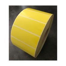 Zelfklevende etiketten (geel) 100x30mm gestanst met perforatie op Rol Artikel foto